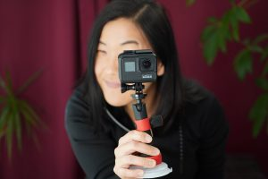 woman looking through a go pro video camera