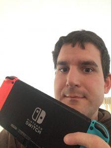 Benjamin Jones holding a Nintendo Switch