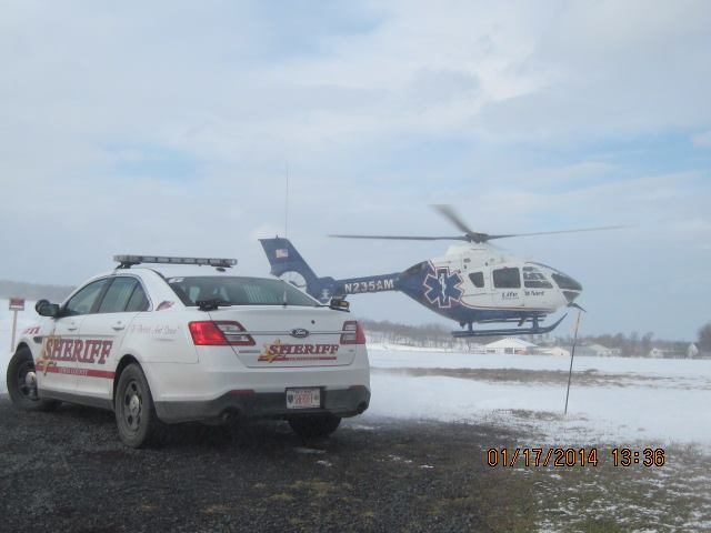 Medical Transport Helicopter touches down in Lewis County by a Sheriff's patrol car.