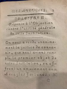 an example of early raised type printing (type is in French)