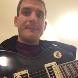 Benjamin Jones holding his guitar